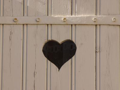 A White Picket Fence with a Black Heart Cut Out--Photographic Print