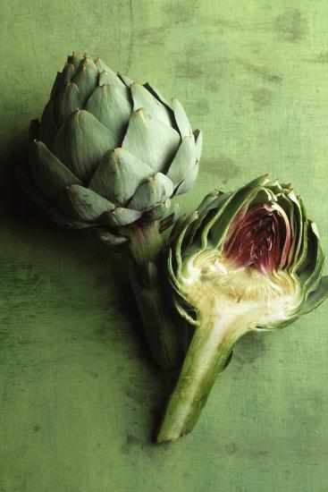 A Whole and a Half Artichoke on Green Background-Studio DHS-Photographic Print