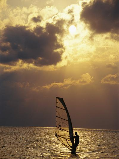 A Windsurfer Skims the Water, Silhouetted by Evening Sun on Pamlico Sound-Stephen St^ John-Photographic Print