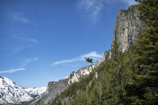 A Wingsuit Pilot Flying Near a Mountain-Chad Copeland-Photographic Print