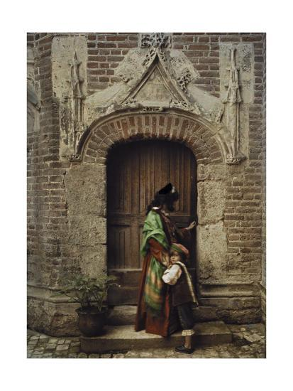 A Woman and Child Use the Yard Door to Exit the Castle-Gervais Courtellemont-Photographic Print