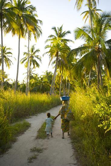 A Woman and Her Son Walking Between Fishing Villages On Matemo Island-Jad Davenport-Photographic Print
