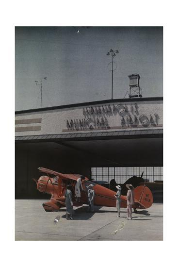 A Woman Exits a Plane with Help While Other People Watch-Willard Culver-Photographic Print