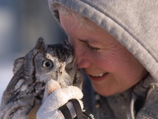 A Woman Holds an Endangered Eastern Screech Owl at a Recovery Center-Joel Sartore-Photographic Print