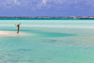 A Woman in a Bikini Posing in the Turquoise Waters at Bora Bora-Mike Theiss-Photographic Print