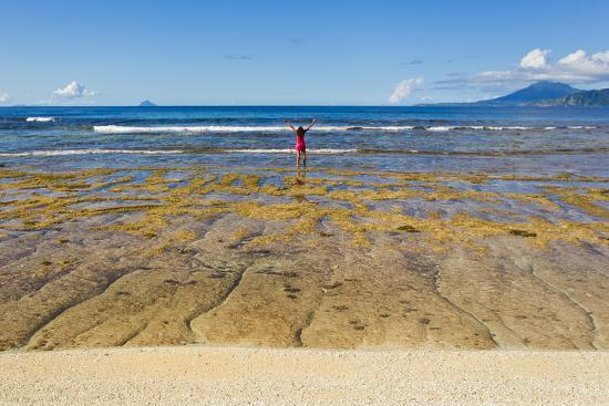 A Woman in a Pink Shirt Takes in a View of the Pacific Ocean from One the Batanes Islands-Mike Theiss-Photographic Print