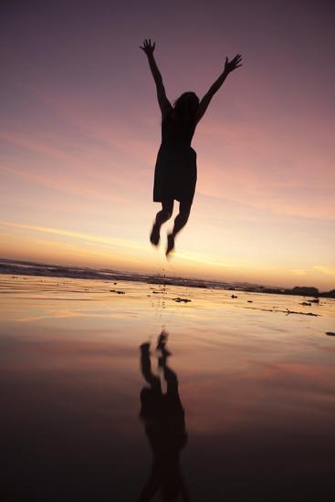 A Woman Jumping on the Beach at Sunset-Macduff Everton-Photographic Print