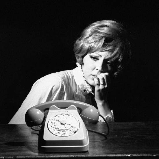 A Woman Looking at a Phone-Marisa Rastellini-Photographic Print