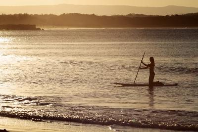 A Woman on a Stand-Up Paddleboard Heads Towards Main Beach, Noosa, at Sunset-William Gray-Photographic Print