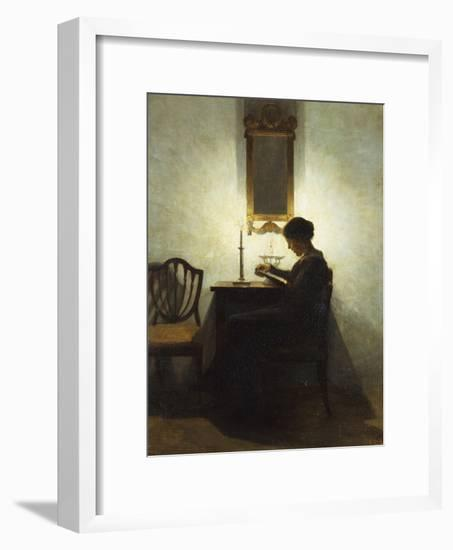 A Woman Reading by Candlelight in an Interior-Peter Ilsted-Framed Giclee Print