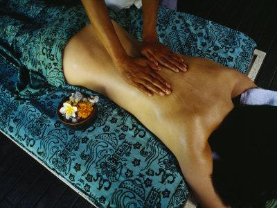 https://imgc.artprintimages.com/img/print/a-woman-receives-a-traditional-balinese-oil-massage-a-bowl-of-tropical-flowers-sits-nearby_u-l-p4od9j0.jpg?p=0