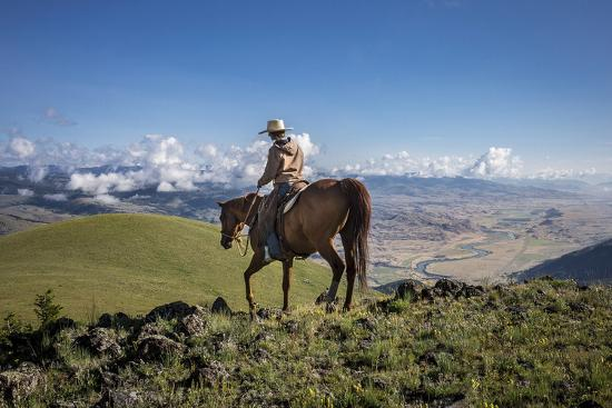A Woman Rides the Range Above the Anderson Ranch to Deter Predators from the Cattle-Cory Richards-Photographic Print