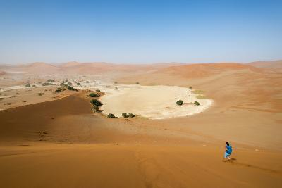 A Woman Runs Down from the Summit of Sossusvlei Sand Dune, Namibia, Africa-Alex Treadway-Photographic Print