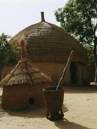 https://imgc.artprintimages.com/img/print/a-woman-s-house-with-a-granary-in-the-foreground-in-a-hausa-village-compound_u-l-q1fmy4v0.jpg?p=0