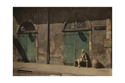 https://imgc.artprintimages.com/img/print/a-woman-sits-outside-the-doorway-of-new-orlean-s-absinthe-house_u-l-pok5g60.jpg?p=0