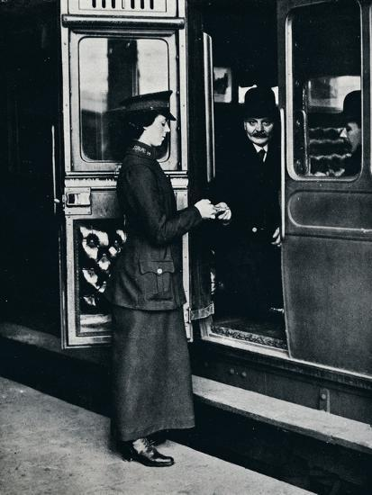 A woman ticket inspector at work, c1914-Unknown-Photographic Print