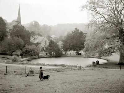 A Woman Walking Her Border Collie Dog in the Countryside--Photographic Print