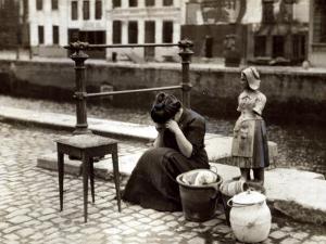 A Woman Weeps at the Roadside Beside Her Worldly Treasures, WWI, Antwerp, Belgium, August 1914