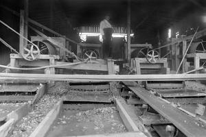 A Worker Stands over a Rock or Gravel Processing Facility, Ca. 1910