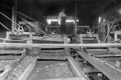 A Worker Stands over a Rock or Gravel Processing Facility, Ca. 1910--Photographic Print
