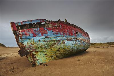 A Wrecked Boat Lying Among Sand Dunes-Nigel Hicks-Photographic Print