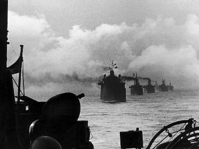 A WW2 Convoy of Steam Supply Ships Sailing Along the English Coast, 1942--Photographic Print