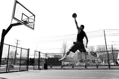 A Young Basketball Player Flying towards the Rim for a Slam Dunk.-ARENA Creative-Photographic Print