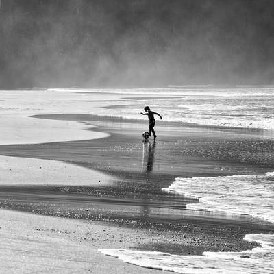 https://imgc.artprintimages.com/img/print/a-young-boy-kicks-a-ball-on-itamambuca-beach-in-ubatuba-brazil_u-l-pu78ke0.jpg?p=0