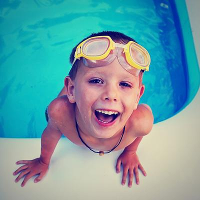 https://imgc.artprintimages.com/img/print/a-young-boy-swimming-in-a-small-pool_u-l-q1036dd0.jpg?p=0