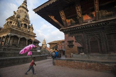 A Young Cotton Candy Seller Walking Through Durbar Square-Michael Melford-Photographic Print