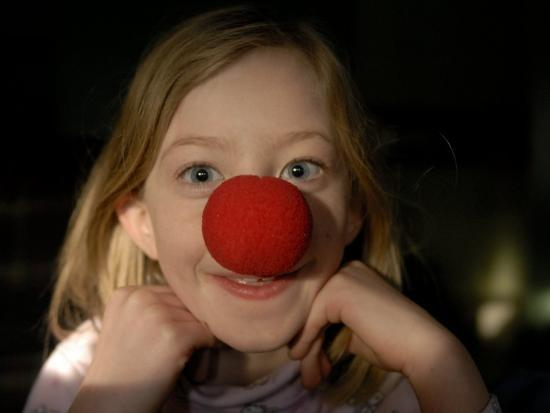 A Young Female Sports a Bright Red Clown Nose-Joel Sartore-Photographic Print