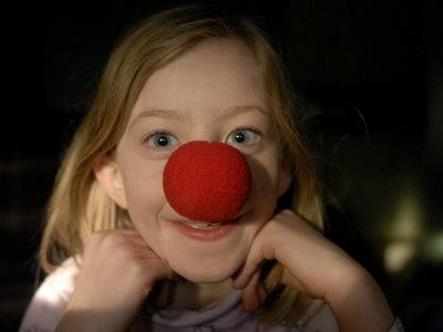 https://imgc.artprintimages.com/img/print/a-young-female-sports-a-bright-red-clown-nose_u-l-p4aio70.jpg?p=0
