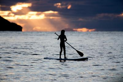 A Young Girl on a Stand Up Paddle Board on Baleia Beach at Sunset-Alex Saberi-Photographic Print