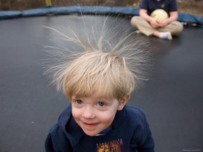 A Young Male Plays on a Trampoline Which Causes His Hair to Stick Up-Joel Sartore-Photographic Print