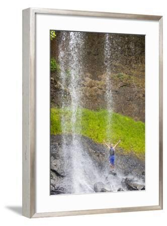 A Young Man Standing in the Cascading Water of Ngardmau Waterfalls-Mike Theiss-Framed Photographic Print