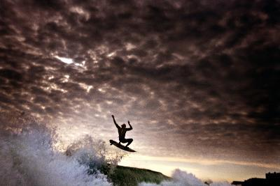 A Young Man Surfs on a Wave on the Outer Banks of North Carolina-Chris Bickford-Photographic Print