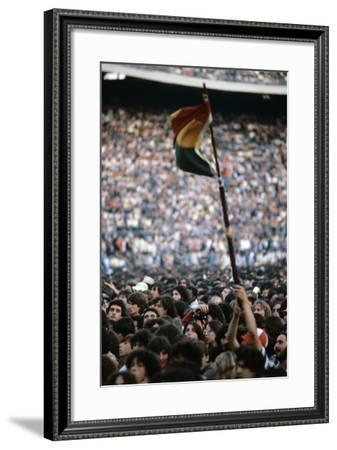 A Young Man Waving the Rasta Flag--Framed Photographic Print