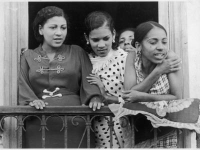 https://imgc.artprintimages.com/img/print/a-young-woman-and-a-group-of-pretty-teenage-girls-on-a-balcony-in-havana-cuba-west-indies_u-l-q108ai50.jpg?p=0