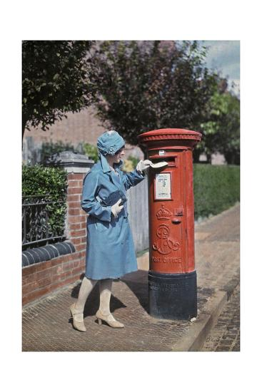A Young Woman Mails a Letter at the Pillar Box-Clifton R^ Adams-Photographic Print