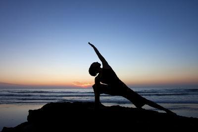 A Young Woman Performs Yoga at Blacks Beach in San Diego, California-Brett Holman-Photographic Print