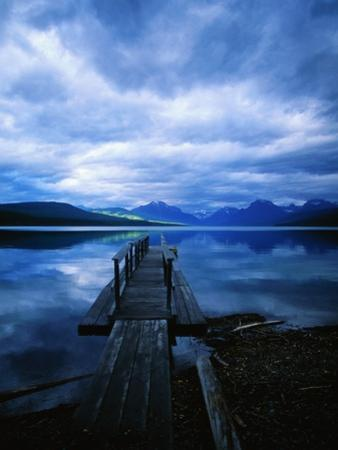 Pier at Lake McDonald Under Clouds by Aaron Horowitz