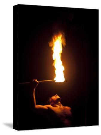 A Fire Knife Dancer Performs at the Tiki Village Theatre
