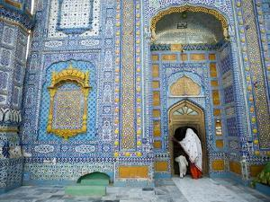 A Woman and Child Entering a Sufi Shrine in Sindh Province, Pakistan by Aaron Huey