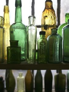 Glass Bottles in an Antique Shop by Aaron Huey