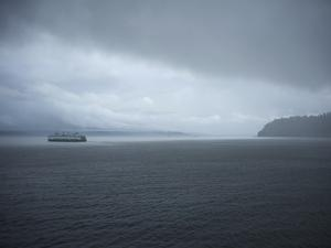 A Ferry Boat Moves Through Stormy Weather From Vashon Island to West Seattle. Washington State, USA by Aaron McCoy