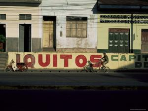 Bicycle Cruises Past Homes, Iquitos, Peru, South America by Aaron McCoy