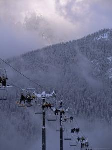 Chair Lift Filled with Skiers and Snowboarders, Washington State, USA by Aaron McCoy