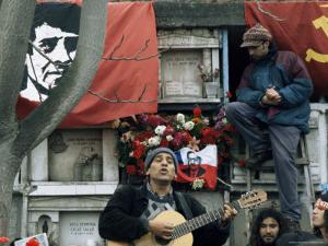 Guitarist Plays Victor Jara Songs at His Grave on 11th De Septiembre, Chile, South America by Aaron McCoy