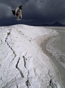 Jumping Above the Borax Deposits on Borders of Laguna Colorado, Bolivia, South America by Aaron McCoy