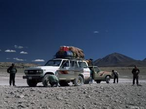 Landcruisers and Tourists on Jeep Tour Taking a Break on Uyuni Salt Flat, Bolivia, South America by Aaron McCoy